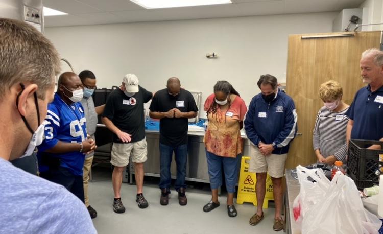 Volunteer prayer time after serving meals